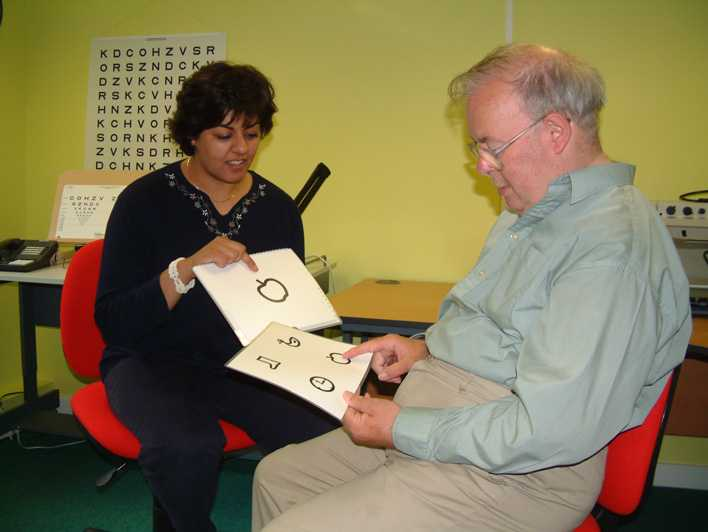 A picture of the person using symbols in an eye examination. Link to Learning Disabilities group